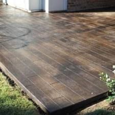 This might be ONE stamped concrete I would approve of. Stamped concrete patios can be made to look like stone, wood, slate, etc. and stained a variety of colors. This might be ONE stamped concrete I would approve of Outside Living, Outdoor Living, Br House, Patio Pergola, Diy Patio, Backyard Patio, Stained Concrete, Concrete Wood, Concrete Floors