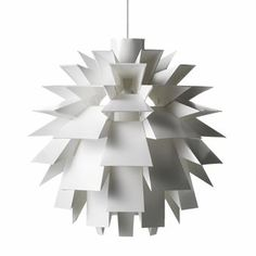"""The+Norm+69+was+designed+by+the+architect+Simon+Karkov+in+1969+and+is+made+up+of+69+pieces.+The+design+leads+to+maximum+distribution+of+light+without+the+blinding+effect.+The+lamp+was+awarded+the+Formland+price+in+2002+and+was+even+awarded+""""Best+item""""+at+the+IMM+in+Cologne.+The+Norm+69+is+available+in+four+different+sizes."""