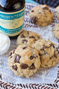 You'd never guess that these thick, soft and chewy coconut oil oatmeal chocolate chip cookies are butter-free! That's because they're packed full of amazing tropical flavor! #coconutoil #oatmealchocolatechip #chocolatechipcookies #coconut #oatmealcookies #cookies