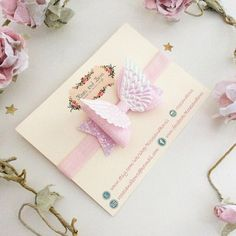 Beautiful fairy wings how Headband or Clip Material: The bow is made from a. Hunky glitter base, fine glitter loops and finished with a fairy wings embellishment. Size:  The bow measures approximately 8cm. The bow is permanently attached to your choice of:  a crocodile clip lined