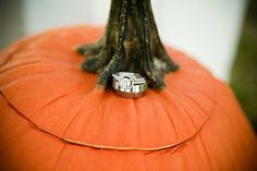 Our wedding rings on a pumpkin - great for fall wedding!