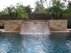 Swimming Pools with Stone work and waterfall - Swimming Pool Designs Ideas.