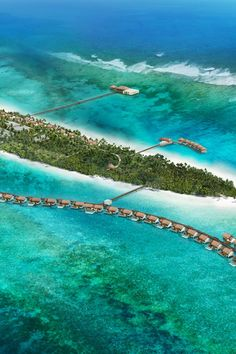 Thatch-roofed Water Villas hover above the Indian Ocean. The Residence Maldives (Falhumaafushi, Maldives) - Jetsetter