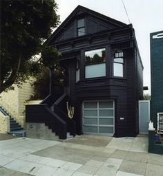 Blackhouse. It never occurred to me to paint my house black. But this looks nice!