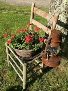 Old chair and lantern with flowers