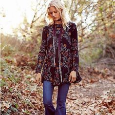 Free People Smooth Talker Floral Print Tunic Floral printed crepe tunic with ruffled hem and low V-back with strap detail. Hip pockets. Free People Tops Tunics