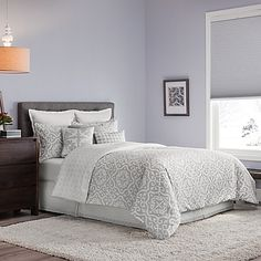 Stylish and sophisticated, the Real Simple Irving Reversible Duvet Cover Set will update your space with a beautiful scrolling medallion print in white on a grey ground. Reversing to a small diamond medallion, complete the look with matching pillow shams.
