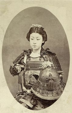 A rare vintage photograph of a geisha or kabuki actress playing an onna-bugeisha, one of the female warriors of the upper social classes in feudal Japan.