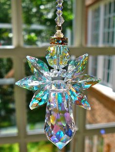 Angelina AB Gold Trimmed - 6 Swarovski Crystal Angel - Suncatcher for Home or Car Rear View Mirror. $26.00, via Etsy.