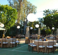 This outdoor event lighting design incorporated the Chinese lanterns with LED pin spots vs. the standard bistro lights. This allows you to specifically place the pin spot on the cable.  Lighting by: http://www.eventilluminations.com