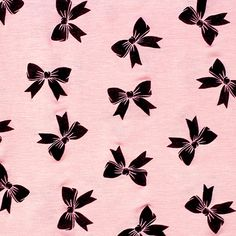 """Black Bows on Pink Jersey Blend Knit Fabric - Kitschy cool  black bow silhouettes on a rose pink color cotton jersey rayon blend knit.  Fabric has a good stretch, and is light weight.  Bows measure 1 3/4"""" (see image for scale).  ::  $6.00"""