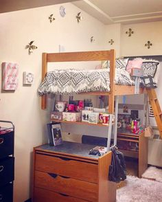 I like the extra shelf under the bed...University of Michigan Dorm Room