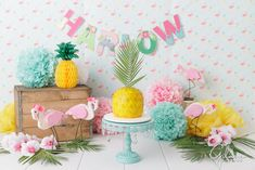 Flamingo Themed 1st Birthday party, pineapple cake, buttercream, frosting, yellow cake, one year old, cake stand, props, background, backdrop, banner, flamingos, theme, Hawaii, GilmoreStudios.com