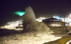 As storm Abigail hits Aberystwyth in the dark stong winds and a high tide combine to generate huge waves. Waves crash against the defences of the new bandstand under constuction on the promenade.