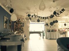 You can easily decorate on a budget, i bought balloons in white, black and silver and hung them in different ways from the ceiling and it really made the room festive and beautiful at night
