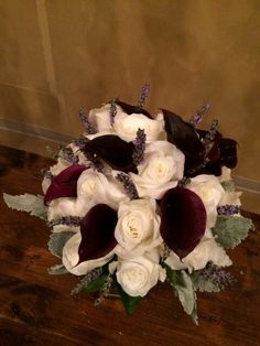 plum calla lilies and english lavender add color to this white rose bouquet