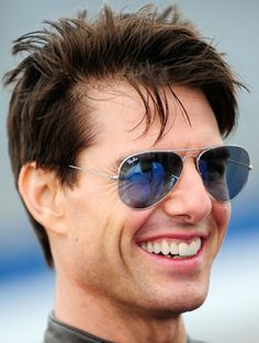 Tom Cruise wearing a neat pair of cool blue aviator sunglasses.  Doesn't he look happy in those aviators?