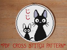 ** Please be aware that this listing is for a printable PDF cross stitch pattern via download and not a completed sampler**  This cute pattern features Jiji, the sarcastic (at least in the English dubbed version) black cat from the Studio Ghibli movie, Kikis Delivery Service, as well as the black cat doll that was KiKis first delivery job. The red hiragana characters read Jiji and you can stitch them in any colour you like. This pattern is specifically designed to fit neatly into a 6 inch…