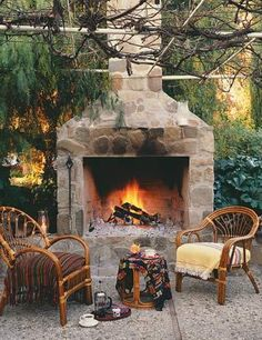 Inspiration for creating a cozy backyard scenario with fireplaces . . .