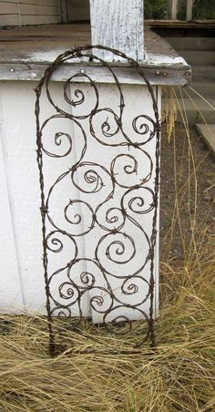 barbed wire trellis - I could do this! I have a ton of old barbed wire. Wire Trellis, Garden Trellis, Garden Crafts, Garden Projects, Barbed Wire Art, Outdoor Projects, Outdoor Decor, Deco Originale, Wire Fence