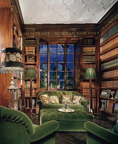 Beautiful library with wood against the green. Especially like the gold, Latin words stenciled around the ceiling edge.