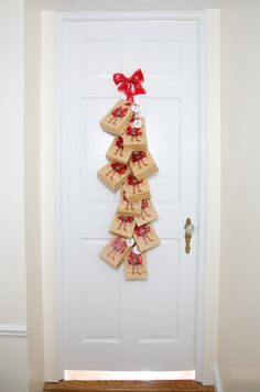 Love this idea from the Chicago Tribune Magazine: Advent Calendar or 12 Days of Christmas calendar. Little IKEA paper bag holds giftie or treat; each bag stapled to a long sturdy ribbon; ribbon tacked onto door or wherever. Detach one bag per day. Genuis!