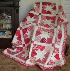A beautiful quilt - sawtooth star with a 9-patch look in varying shades of 1 color. <3