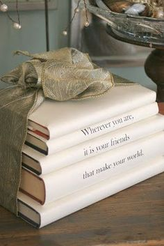 Print quotes on book covers I am always on the lookout for places to put quotes as words are just about my favorite decor element. This stack of books with a quote printed on the white paper book covers is a great idea that a… Old Books, Vintage Books, Paper Book Covers, Old Book Crafts, Book Spine, White Books, Painted Books, Book Projects, Diy Projects