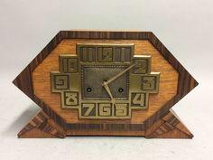 Art Deco houten pendule met bronzen wijzerplaat