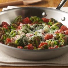 Broccoli and tomato recipe combining frozen broccoli with Italian flavored tomatoes and finished with Italian blend cheese