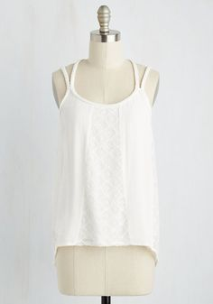 Your honey across the table will agree - you're sweeter than sugar, and this white tank proves it! While your mug of coffee warms your hands, the boho beauty of this top's braided straps, breezy jersey knit, and lace panels warms your heart and enchants your date. What a dream come 'brew'.
