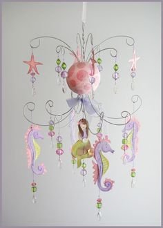 Purple and Pink Mermaid chandelier mobile. $155.00, via Etsy.... Thinking I could make it.