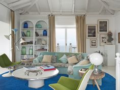 colour + pattern in eclectic living room by maria llado