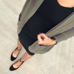 Dress up a tiny baby bump in a little black dress, ballet flats, and a long cardigan.