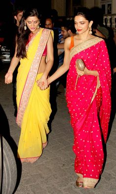 Deepika Padukone In A Bright Pink Embellished #Saree With Orange #Blouse & Nargis Fakhri In A Yellow #Saree With Pink #Blouse At Aamir Khan's Diwali Bash.