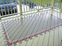 PAINT a rug on the porch floor!