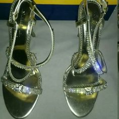 Gold Sandals with Crystal Detail Gold sandals with crystal detail on straps. Only wore once to a wedding. They are in excellent shape. Light wear on the soles, but no wear on the heels. These will definitely be a conversation piece. Marichi Maui Shoes Sandals