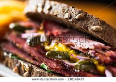 Detail of pastrami sandwich with french fries ready to eat.
