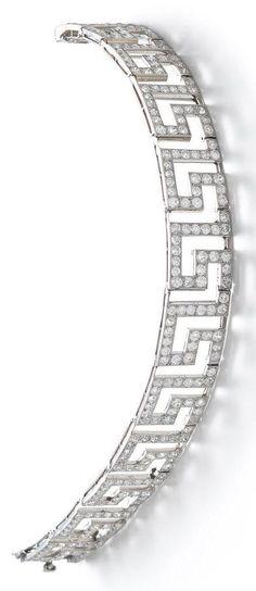 Cartier - An Art Deco diamond bracelet, circa 1930. The openwork articulated strap designed as a series of repeating Greek key pattern motifs, set throughout with brilliant-cut diamonds, signed Cartier Paris, diamonds approximately 7.00 carats total. #Cartier #ArtDeco