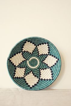 Woven basket, mint green, white and black.
