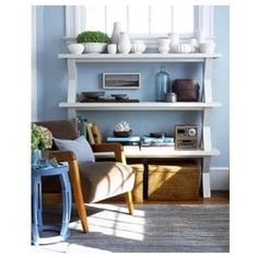 A single bench is useful for sitting down and putting on shoes, but three benches stacked on top of one another become an entirely different piece in your home. Instantly, three shelves are available for organizing your collections and books. To do: Paint the benches all the same color and secure them to each other with the appropriate hardware