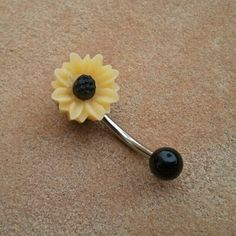 Sunflower Belly Button Jewelry Stud Ring- Daisy Navel Piercing Bar Barbell Yellow Azeetadesigns. $15.00, via Etsy.