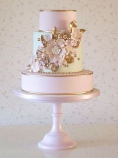 Very pretty...beautifully gold trimmed pink cake. I'm seeing a trend in pink cakes.