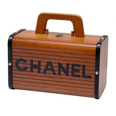 Rare Vintage Chanel Wood & Leather Handbag   From a collection of rare vintage handbags and purses at http://www.1stdibs.com/fashion/accessories/handbags-purses/