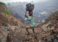 A boy carries coal at an open cast coal field at Dhanbad district in the eastern Indian state of Jharkhand September 20, 2012. With oil and gas output disappointing and hydropower at full throttle, Asia's third-largest economy still relies on coal for most of its vast energy needs. About 75 percent of India's coal demand is met by domestic production and, according to government plans, that won't change over the next five years.
