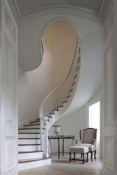 Curtis Windham - Architect - Houston - Neoclassical - Staircase - White - Curved - Upholstered Chair - Upholstered Footrest - Table - Crisp
