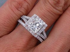 This is our alluring 2.15 ctw Princess Cut Diamond Engagement Ring and Matching Wedding Band Set. It has a glittering 1.51 ct Princess Cut H Color/SI1 clarity, Clarity Enhanced (Fracture Filled) Center Diamond. Set in a gorgeous custom designed setting and including a matching wedding band, this set is listed for $8,990!