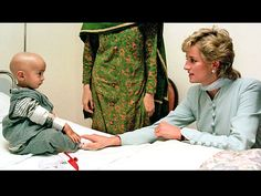 LAHORE, PAKISTAN  The Princess reaches out to a young cancer patient while visiting Pakistan in February 1996.