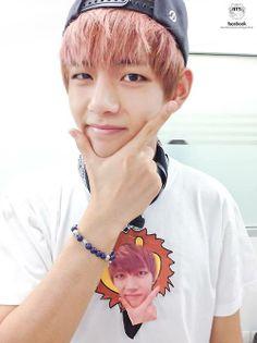Taehyung<3 I love how his shirt has him doing the exact same thing :P