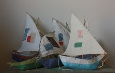 papier mache boats with fabric sails. amazing! (tutorial here http://annwood.net/blog/2009/12/11/paper-mache-boat-pattern)